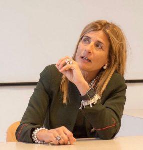 """Qui sopra, Michela Ricolfi, ambacsiatrice in Umbria di di """"EnterprisinGirls. In alto, Palazzo dei Priori a Perugia"""