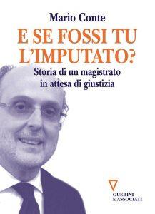 Qui sopra, la copertina del libro. In alto, ol magistrato con Antonio Di Pietro